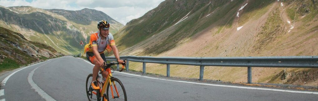 Aigars Paegle the owner of HC Bike Tours cycling in the Dolomites Italy