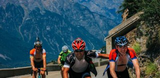 Happy guests cycling the Franch Alps with HC Bike Tours