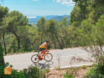 Aigars Paegle riding Coll de sa Creu in Mallorca with our cycling camp guests