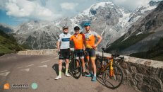 HC Bike Tours Ride Leader with guests at the infamous cycling climb Passo dello Stelvio in Italy