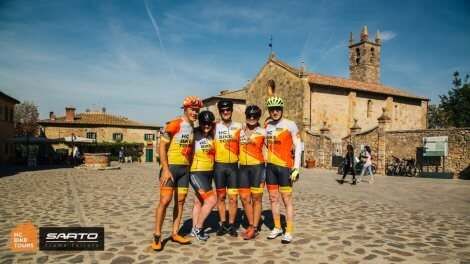 Aigars Paegle with our guests from Canada in Monteriggioni on Tuscany Private Custom bike trip organized by HC Bike Tours